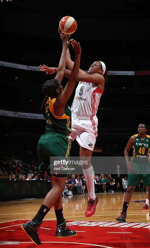 <a gi-track='captionPersonalityLinkClicked' href=/galleries/search?phrase=Kia+Vaughn&family=editorial&specificpeople=4220876 ng-click='$event.stopPropagation()'>Kia Vaughn</a> #9 of the Washington Mystics shoots against <a gi-track='captionPersonalityLinkClicked' href=/galleries/search?phrase=Nakia+Sanford&family=editorial&specificpeople=227934 ng-click='$event.stopPropagation()'>Nakia Sanford</a> #43 of the Seattle Storm at the Verizon Center on July 6, 2012 in Washington, DC.