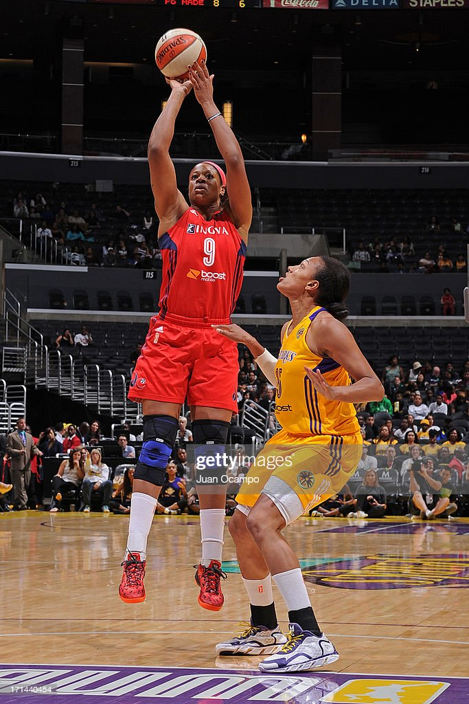 <a gi-track='captionPersonalityLinkClicked' href=/galleries/search?phrase=Kia+Vaughn&family=editorial&specificpeople=4220876 ng-click='$event.stopPropagation()'>Kia Vaughn</a> #9 of the Washington Mystics shoots the ball against the Los Angeles Sparks at Staples Center on June 23, 2013 in Los Angeles, California.
