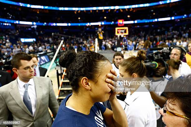 Kiah Stokes of the Connecticut Huskies celebrates on the court after defeating the Notre Dame Fighting Irish 6353 during the NCAA Women's Final Four...