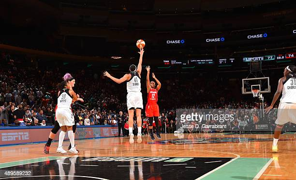 Kiah Stokes of the New York Liberty blocks the shot with seconds left in the game against the Washington Mystics during game One of the WNBA...