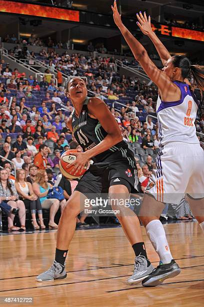 Kiah Stokes of the New York Liberty drives to the basket and looks to shoot the ball against the Phoenix Mercury on July 18 2015 at Talking Stick...
