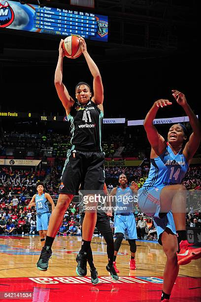 Kiah Stokes of the New York Liberty grabs a rebound against the Atlanta Dream during a WNBA game on June 22 2016 at Philips Arena in Atlanta Georgia...