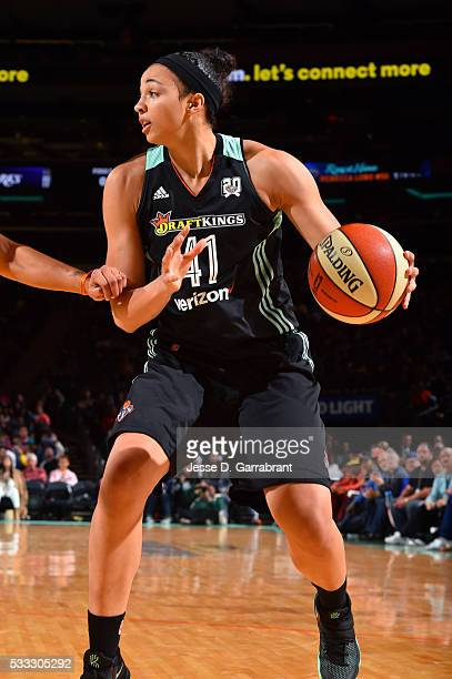 Kiah Stokes of the New York Liberty handles the ball during the game against the Los Angeles Sparks on May 21 2016 at Madison Square Garden in New...