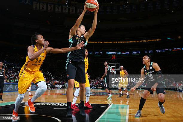 Kiah Stokes of the New York Liberty passes the ball against Tamika Catchings of the Indiana Fever on July 21 2016 at Madison Square Garden in New...