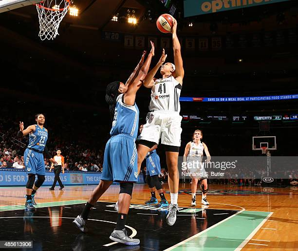 Kiah Stokes of the New York Liberty shoots against Asjha Jones of the Minnesota Lynx on August 28 2015 at Madison Square Garden New York City New...