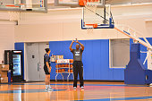 Kiah Stokes the New York Liberty and assistant coach Herb Williams work on things during practice at the New York Knicks training facility on...