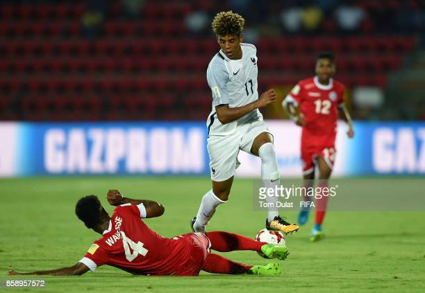 Kiam Wanesse of New Caledonia and Willem Geubbels of France in action during the FIFA U17 World Cup India 2017 group E match between New Caledonia...