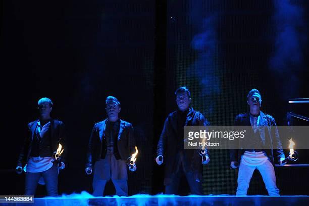 Kian Egan Shane Filan Mark Feehily and Kian Egan of Westlife performs on stage at Motorpoint Arena on May 13 2012 in Sheffield United Kingdom