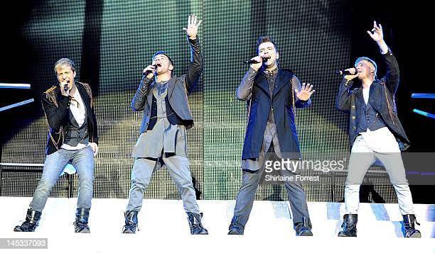 Kian Egan Shane Filan Mark Feehily and Nicky Byrne of Westlife perform at MEN Arena as part of their farewell tour on May 26 2012 in Manchester...