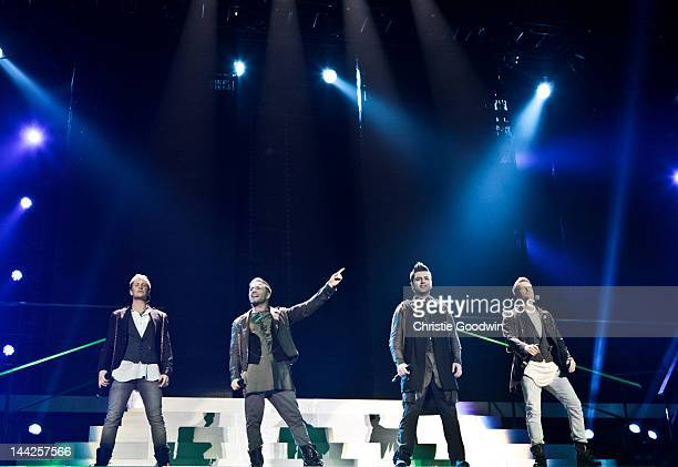 Kian Egan Shane Filan Mark Feehily and Nicky Byrne of Westlife perform on stage during the band's farewell tour at O2 Arena on May 12 2012 in London...