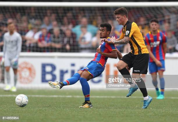 Kian Flanagan of Palace battles with Jack Paxman of Maidstone during the Pre Season Friendly match bewteen Maidstone United and Crystal Palace at the...