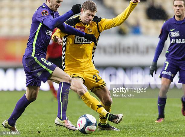 Kian Hansen of FC Midtjylland and Andre Bjerregaard of AC Horsens compete for the ball during the Danish Alka Superliga match between AC Horsens and...