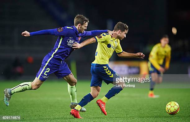 Kian Hansen of FC Midtjylland and Andrew Hjulsager of Brondby IF compete for the ball during the Danish Alka Superliga match between Brondby IF and...