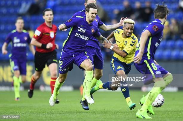 Kian Hansen of FC Midtjylland and Hany Mukhtar of Brondby IF compete for the ball during the Danish Alka Superliga match between Brondby IF and FC...