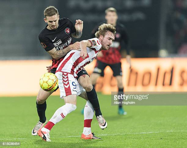 Kian Hansen of FC Midtjylland and Jannik Pohl of AaB compete for the ball during the Danish Alka Superliga match between FC Midtjylland and AaB...