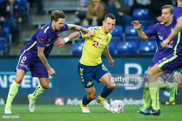 Kian Hansen of FC Midtjylland and Kamil Wilczek of Brondby IF compete for the ball during the Danish Alka Superliga match between Brondby IF and FC...