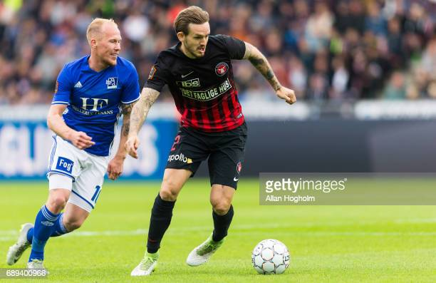 Kian Hansen of FC Midtjylland and Mikkel Rygaard of Lyngby Boldklub compete for the ball during the Danish Alka Superliga match between FC...