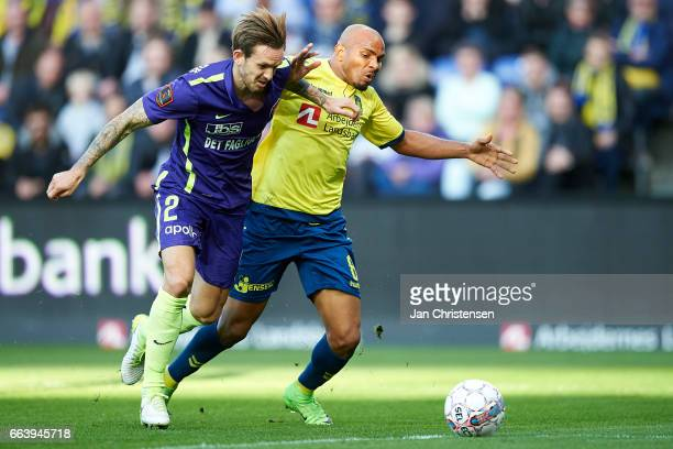 Kian Hansen of FC Midtjylland and Rodolph Austin of Brondby IF compete for the ball during the Danish Alka Superliga match between Brondby IF and FC...