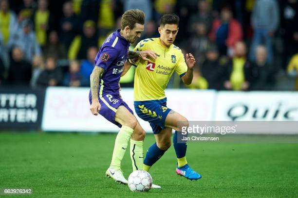 Kian Hansen of FC Midtjylland and Svenn Crone of Brondby IF compete for the ball during the Danish Alka Superliga match between Brondby IF and FC...