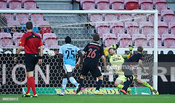 Kian Hansen of FC Midtjylland scores the 22 own goal against Goalkeeper Johan Dahlin of FC Midtjylland during the Danish Alka Superliga match between...