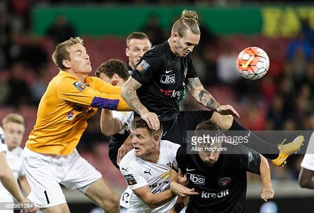 Kian Hansen of Midtjylland and Goalkeeper Jesper Rask of Hobro IK in action during the Danish Alka Superliga match between FC Midtjylland and Hobro...