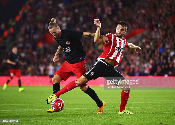 Kian Hansen of Midtjylland is challenged by Jay Rodriguez of Southampton during the UEFA Europa League Play Off Round 1st Leg match between...