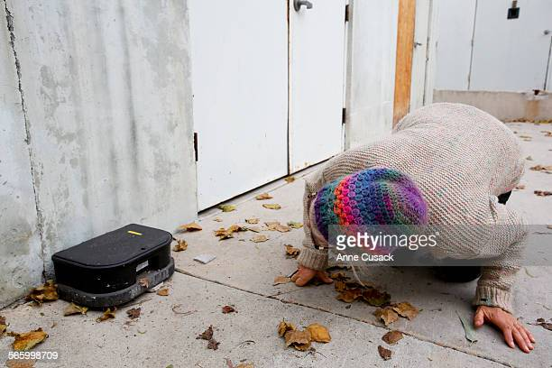 Kian Schulman secretary of the Malibu Agricultural Society checks the label on a rat trap by a business in Malibu as she speaks out to educate...
