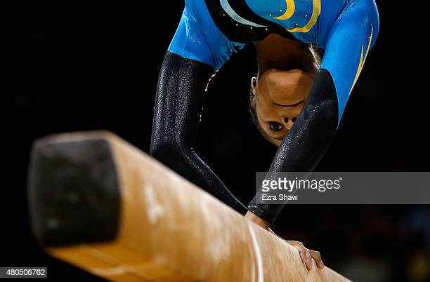 Kianna Dean of the Bahamas competes on the balance beam during the women's artistic gymnastics team final and qualifications on Day 2 of the Toronto...