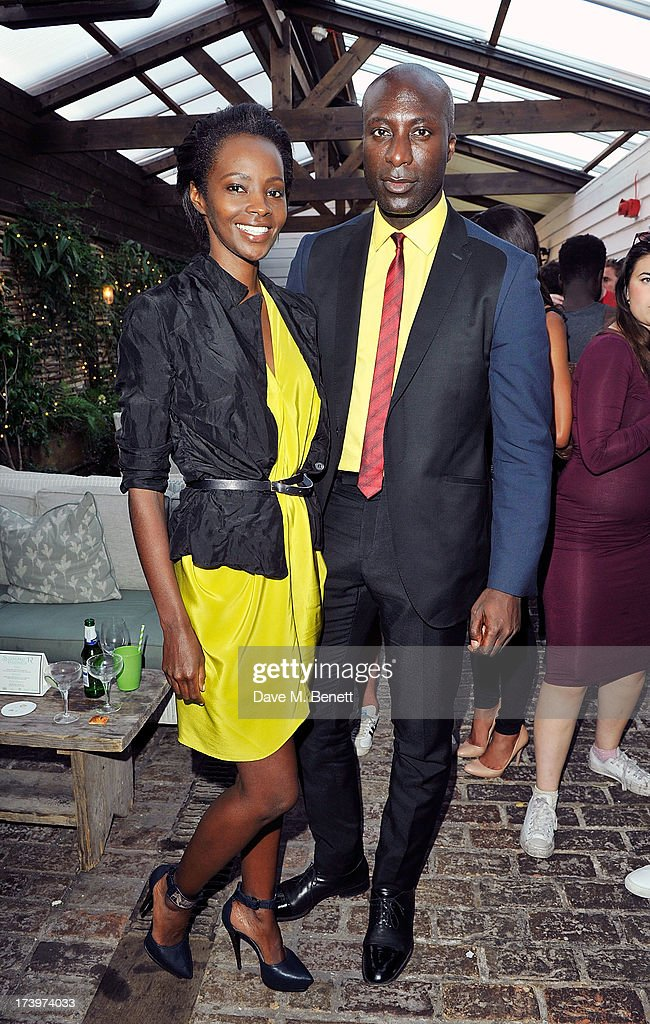 Kiara Kabukuru and Ozwold Boetang attends Warner music group summer party in association with Esquire at Shoreditch House on July 18, 2013 in London, England.