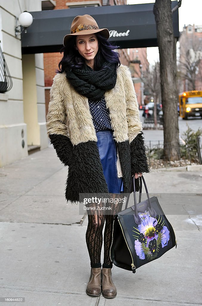Kiara Schwartz, fashion blogger from Vancouver, seen outside the Dannijo jewelry presentation wearing Asos jacket, PJK collection skirt, OTBT shoes, Givenchy bag and a Madewell hat on February 7, 2013 in New York City.