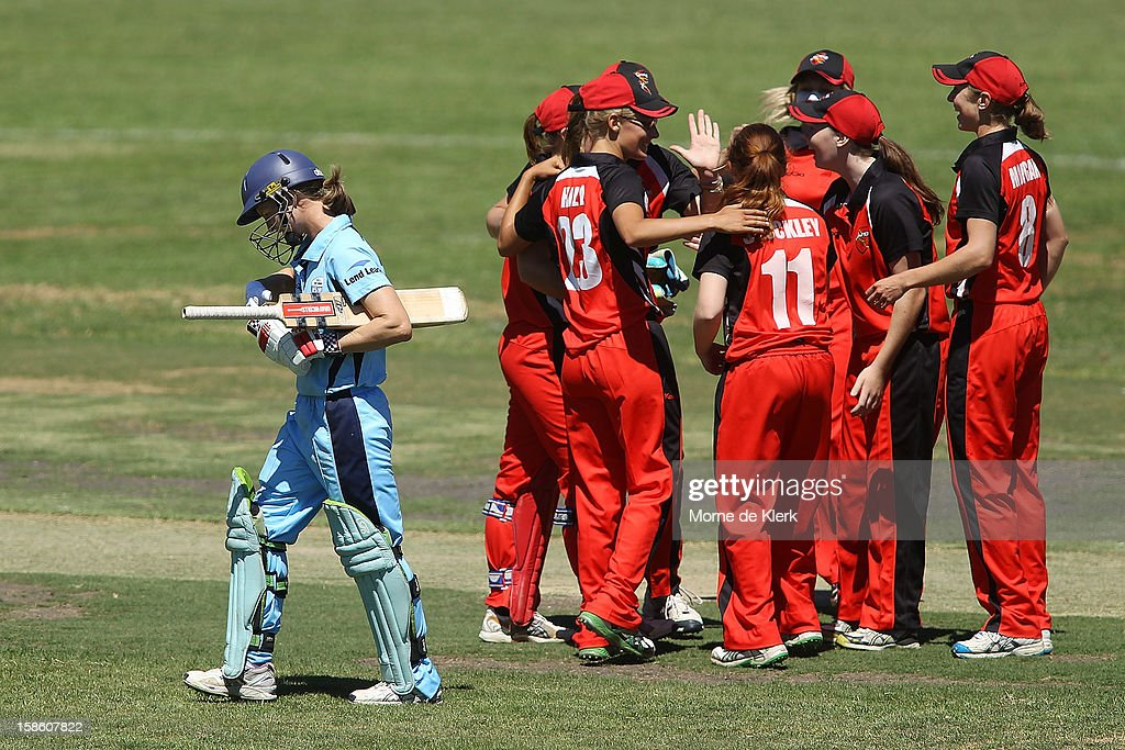 Kiara Stockley of the Scorpions celebrates with team mates after getting the wicket of <a gi-track='captionPersonalityLinkClicked' href=/galleries/search?phrase=Leah+Poulton&family=editorial&specificpeople=855761 ng-click='$event.stopPropagation()'>Leah Poulton</a> (L) of the Breakers during the women's Twenty20 match between the South Australia Scorpions and the New South Wales Breakers at Prospect Oval on December 21, 2012 in Adelaide, Australia.