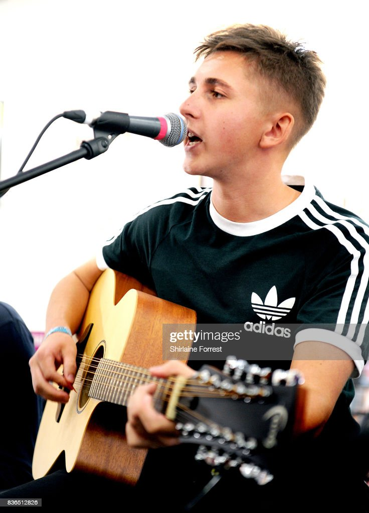 Kiaran Crook of The Sherlocks performs live and signs copies of their debut album 'Live for the Moment' during an instore session at HMV Manchester on August 21, 2017 in Manchester, England.