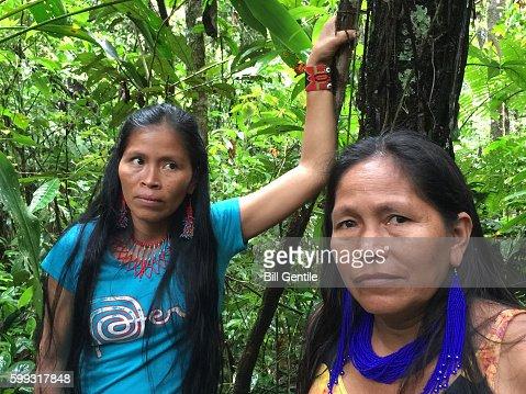 Kichwa Indian women in Ecuadorian Amazon jungle pause to rest