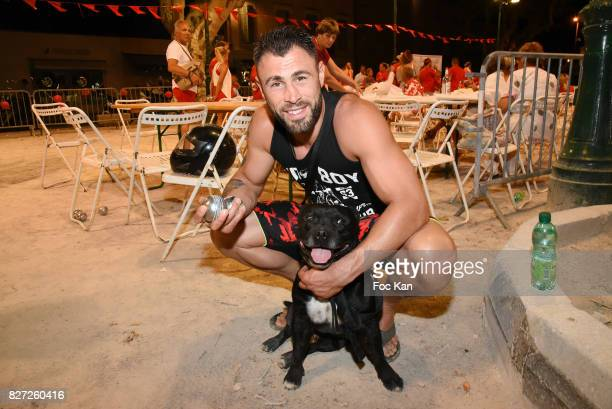 Kick Boxing champion Yohan Lindon and his dog Dyron attend the AJILA Sauvez le coeur des femmes Petanque Auction Competition at Place des Lices on...
