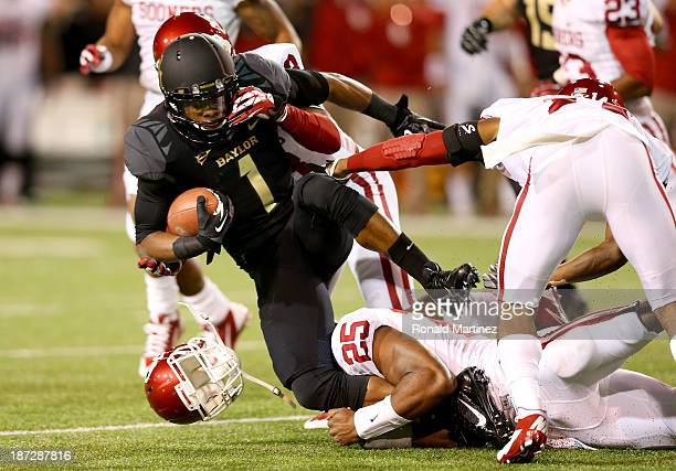 Kick returner Corey Coleman of the Baylor Bears is tackled on the opening kick in the first quarter against the Oklahoma Sooners at Floyd Casey...
