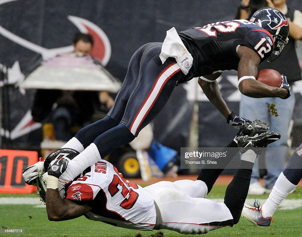 Kick returner <a gi-track='captionPersonalityLinkClicked' href=/galleries/search?phrase=Jacoby+Jones&family=editorial&specificpeople=4167942 ng-click='$event.stopPropagation()'>Jacoby Jones</a> #12 of the Houston Texans is tackled by special teams player <a gi-track='captionPersonalityLinkClicked' href=/galleries/search?phrase=Antone+Smith&family=editorial&specificpeople=2611035 ng-click='$event.stopPropagation()'>Antone Smith</a> #35 of the Atlanta Falcons on December 4, 2011 at Reliant Stadium in Houston, Texas.