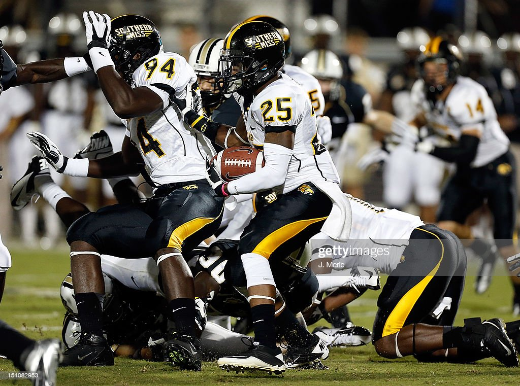 Kick returner Justin Sims #25 of the Southern Mississippi Golden Eagles returns a kick against the Central Florida Knights during the game at Bright House Networks Stadium on October 13, 2012 in Orlando, Florida.