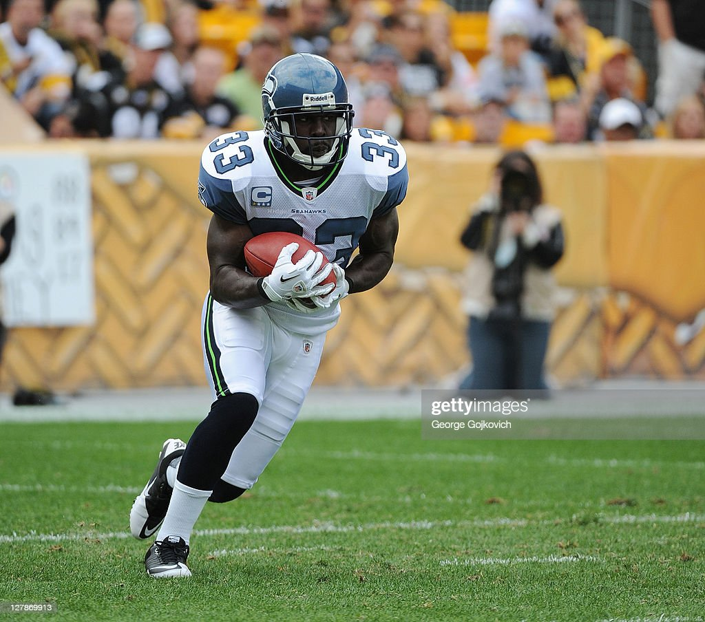 Kick returner Leon Washington of the Seattle Seahawks runs with the football during a game against the Pittsburgh Steelers at Heinz Field on...