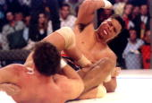 Kickboxer Patrick Smith of Denver CO tries to ward off a kick to the stomach by Toughman champ Ken Shamrock during the Ultimate Fighter Championships...