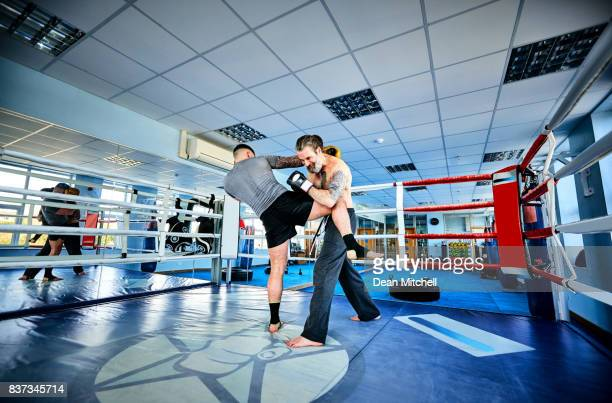 Kickboxers training in the ring