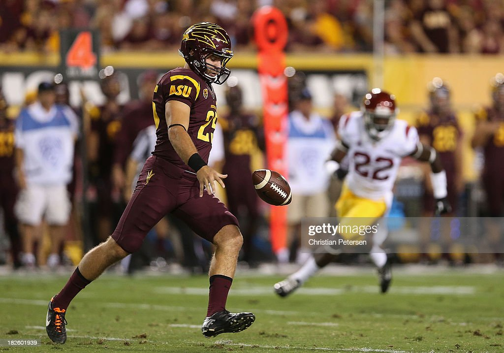 Kicker Alex Garoutte #25 of the Arizona State Sun Devils punts the football during the college football game against the USC Trojans at Sun Devil Stadium on September 28, 2013 in Tempe, Arizona.
