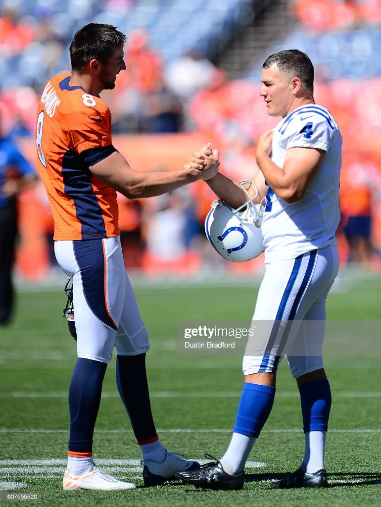 Kicker Brandon McManus #8 of the Denver Broncos and kicker Adam Vinatieri #4 of the Indianapolis Colts shake hands before the game at Sports Authority Field at Mile High on September 18, 2016 in Denver, Colorado.