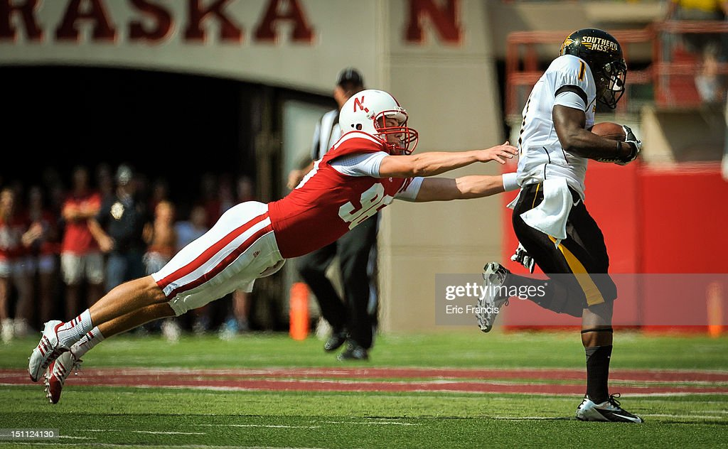 Kicker Brett Maher #96 of the Nebraska Cornhuskers tries to bring down wide receiver Tracy Lampley #1 of the Southern Miss Golden Eagles while returning a kickoff for a touchdown during their game at Memorial Stadium September 1, 2012 in Lincoln, Nebraska. Nebraska won 40-20.