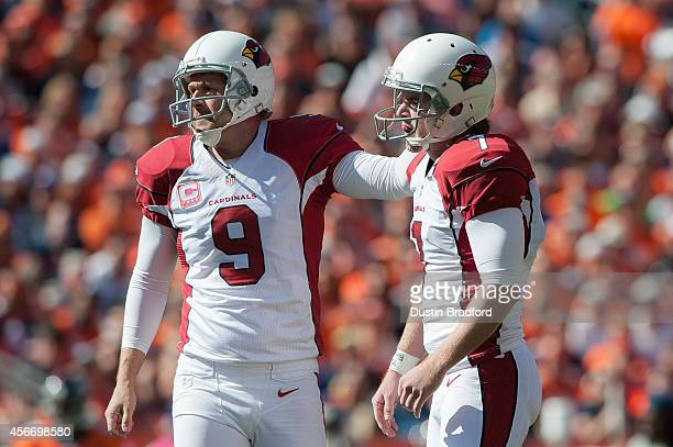 Kicker Chandler Catanzaro and placeholder Dave Zastudil of the Arizona Cardinals celebrate after Catanzaro kicked a 33yard first quarter field goal...