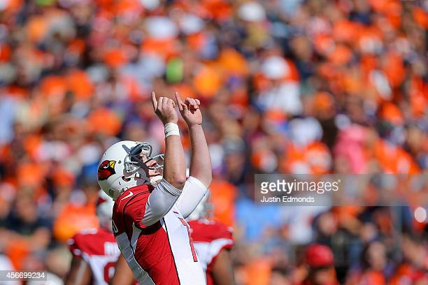 Kicker Chandler Catanzaro of the Arizona Cardinals celebrates a first quarter field goal against the Denver Broncos during a game at Sports Authority...
