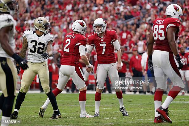 Kicker Chandler Catanzaro of the Arizona Cardinals highfives Drew Butler after kicking a field goal against the New Orleans Saints during the NFL...