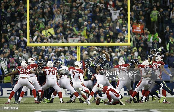 Kicker Chandler Catanzaro of the Arizona Cardinals kicks the gamewinning field goal against the Seattle Seahawks at CenturyLink Field on December 24...