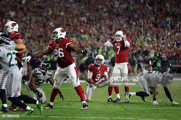 Kicker Chandler Catanzaro of the Arizona Cardinals reacts after hitting the left upright to miss a field goal during overtime of the NFL game against...