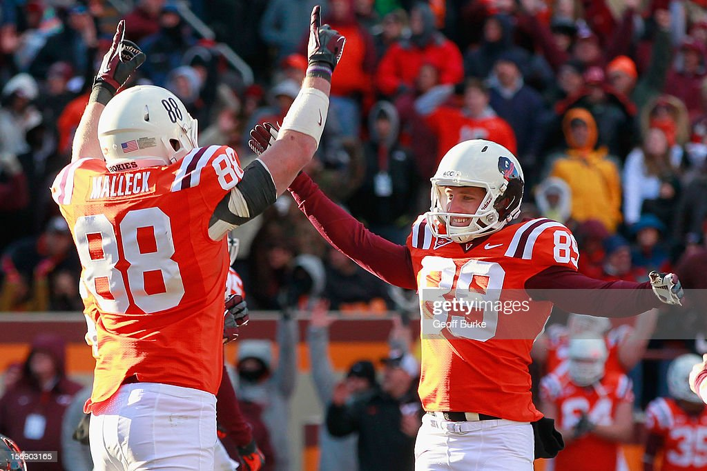 Kicker Cody Journell #89 of the Virginia Tech Hokies celebrates with tight end Ryan Malleck #88 of the Hokies after making the game-winning field goal on the final play against the Virginia Cavaliers at Lane Stadium on November 24, 2012 in Blacksburg, Virginia.