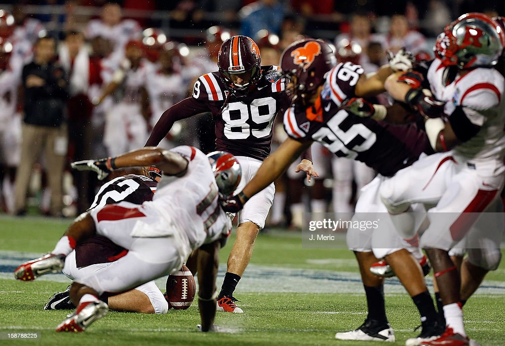 Kicker Cody Journell #89 of the Virginia Tech Hokies kicks what would be the game winning field goal in overtime against the Rutgers Scarlet Knights during the Russell Athletic Bowl Game at the Florida Citrus Bowl on December 28, 2012 in Orlando, Florida.